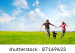 young happy couple running on a ... | Shutterstock . vector #87169633