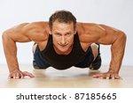 handsome muscular man doing... | Shutterstock . vector #87185665