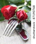 small table setting with red roses - stock photo
