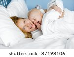 young mother and her laughing... | Shutterstock . vector #87198106