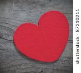 red heart shape on wood with copy space - stock photo