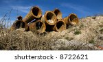 Abandoned rusty pipes from an old pipeline.Panoramic picture, not a crop. - stock photo