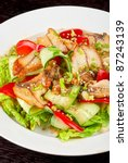 Salad of smoked eel, lettuce,Chinese cabbage and vegetables - stock photo