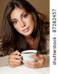 brunette with coffee | Shutterstock . vector #87282457