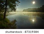 Sunrise At Foggy Lake  In Autumn