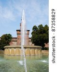 Sforza castle, main entrance at Filarete tower and fountain, Milan, Italy - stock photo