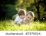 a young boy and girl laying in... | Shutterstock . vector #87370514