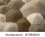 full frame pattern with multicolored flat sand piles to one another - stock photo