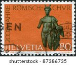Small photo of SWITZERLAND - CIRCA 1986: A stamp printed in Switzerland, dedicated to the Roman Chur Bimillennium, bronze sculpture depicts God Mercury, circa 1986