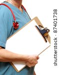 A closeup shot of a healthcare professional with her stethoscope and clipboard. - stock photo