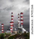 Petro-chemical refinery under an heavy stormy sky. - stock photo