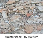 full frame abstract background showing pastel colored broken stones - stock photo