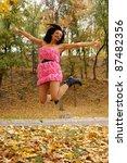 cute girl jumping at an autumn... | Shutterstock . vector #87482356