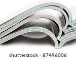 stack of open magazines over... | Shutterstock . vector #87496006