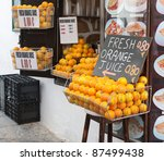 A shop in Greece selling fresh orange juice for â?¬0.80. - stock photo