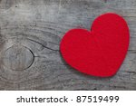 red heart on wood with copy space - stock photo