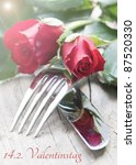 table setting for valentines day with red roses - stock photo