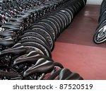 Rows of new bikes on showroom floor - stock photo