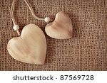 Two Wooden Hearts On Fabric...