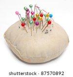Sewing pins and pin cushion - stock photo