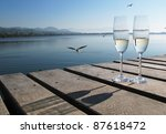 Two Champagne Glasses Against A ...