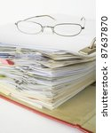 open file folder with spectacles and paper clips - stock photo