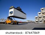 Crane Lifting Up Container In...
