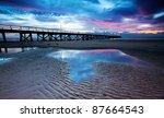 Beautiful pink sunset at the beach - stock photo