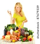 Young woman with groceries isolated on white - stock photo