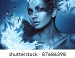 portrait of winter woman with snow splash - stock photo