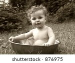 Baby Splashing In A Basin In...