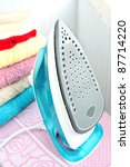 electric iron and stack of... | Shutterstock . vector #87714220