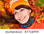 Girl In Autumn Orange Leaves. ...