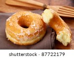 a sugar glazed donut on wood | Shutterstock . vector #87722179
