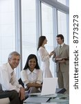 business team of four with two... | Shutterstock . vector #8773273