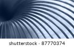 abstract industrial background showing a blue toned detail of a metallic spiral - stock photo