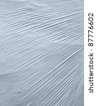full frame abstract detail of some white wrapping foil - stock photo