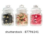 Three Filled Glass Candy Jars...