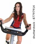 beautiful woman on excercise bike isolated on white background - stock photo