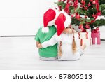 Christmas is awesome - kids looking at the decorated fir tree - stock photo