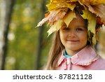 little girl with leaves on her... | Shutterstock . vector #87821128