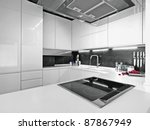 Stock photo white modern kitchen with steel appliances 87867949