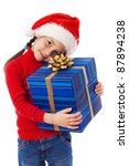 Little girl in Santa hat with blue box, isolated on white - stock photo