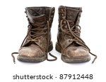 Dirty Old Boots Isolated Over...