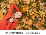 Woman Lying On Autumn Leaves ...