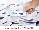 Word strategy in hand, business concept - stock photo