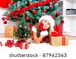 adorable girl with gifts under... | Shutterstock . vector #87962563