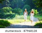 women run by sunny park alley | Shutterstock . vector #87968128