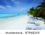 tropical island palm sea and sky | Shutterstock . vector #87968245
