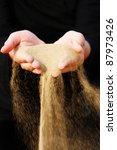 sand running through hands as a ... | Shutterstock . vector #87973426